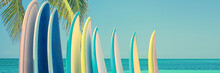 Panorama Of Vintage Colorful Surfboards On A Tropical Beach By The Ocean With Palm Tree