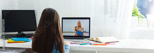 Woman video conferencing with tutor on laptop at home Canvas