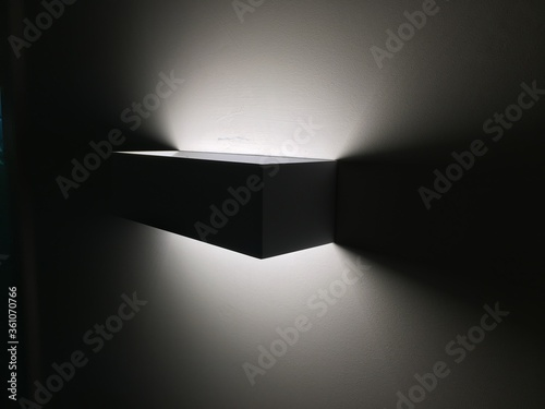 Selective focus shot of a modern light lamp attached to a wall Canvas Print