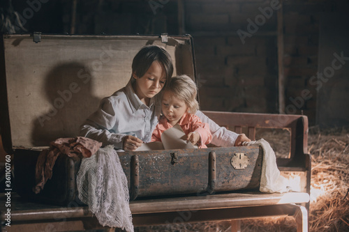Fotomural Little child, boy, hiding in old vintage suitcase in the attic