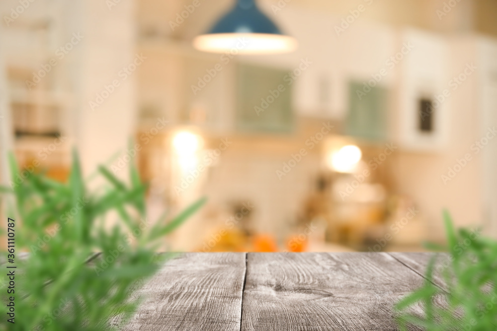 Fototapeta Wooden table with plants in modern kitchen interior