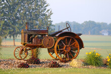 A Rusty Vintage Farm Tractor O...