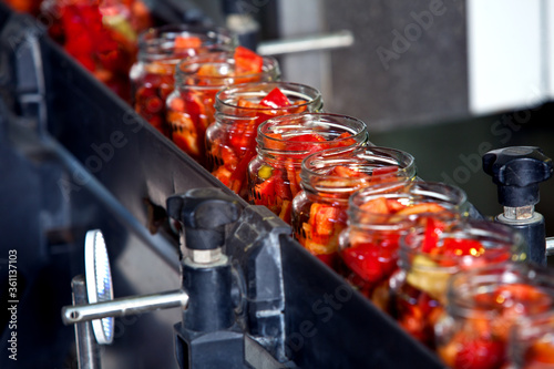 Fototapeta canned bell peppers conveyor production obraz