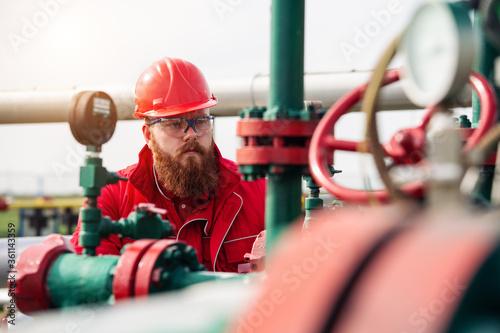 Fototapeta Technician in oil and gas refinery. Worker in Oil Refinery. obraz