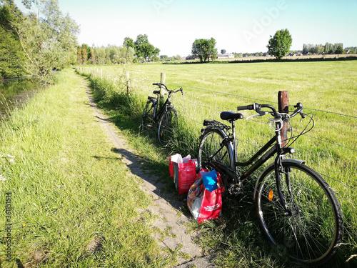 Obraz na plátně bicycle in the field. Countryside. Picnic break.
