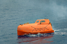 Orange Lifeboat Moving In The ...