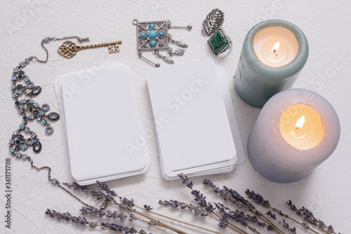Blank tarot cards with copy space on the white table background. Canvas-taulu