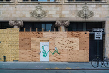 NYC Retailer Small Business Boarding Up Their Storefronts With Plywood Over Ornate Classic Building In Fear Of Looting Damage During The BLM Protests.