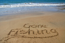 Gone Fishing Written In Sand O...