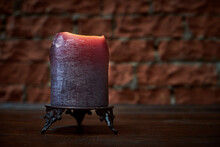 Big Candle On Wooden Table