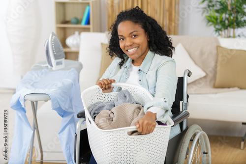 Fototapeta happy disabled woman during ironing obraz