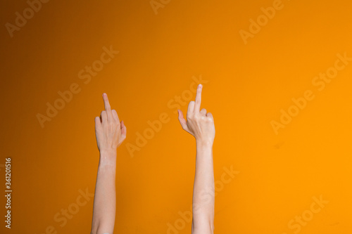 Fototapeta Female hands showing middle fingers to the camera