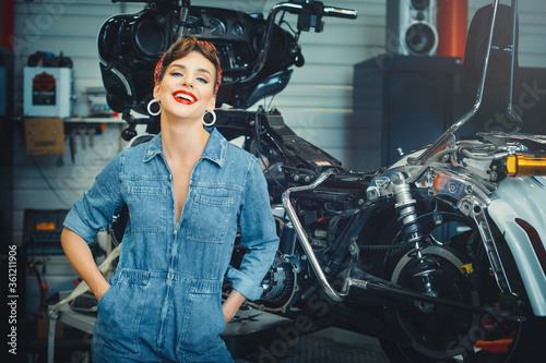 beautiful woman posing near a motorcycle