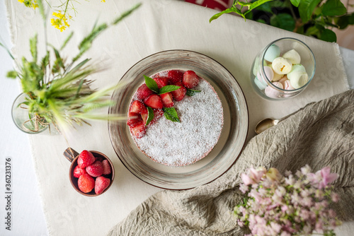Fototapeta Beautiful delicious strawberry raw cake decorated with berries. Concept of delicious and healthy summer desserts obraz