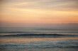Calming sunset on the beach of Pantai Lima with isolated glassy ocean wave, Bali Indonesia.