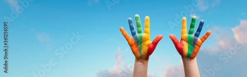 Obraz Panoramic - child with painted hands on a nice sunny day - fototapety do salonu