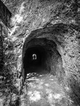 Grayscale Shot Of A Cave Tunne...