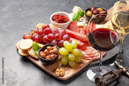 Fototapeta Cheese, meat, grapes and olives antipasto obraz