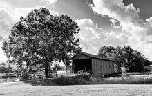Countryside Landscape With Covered Bridge In Black And White