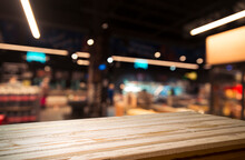 Empty Wood Table Top On Blurre...