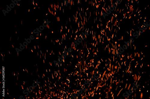 Obraz na plátně flame of fire with sparks on a black background
