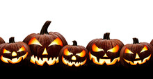 A Group Of Five Spooky Halloween Lanterns, Jack O Lantern, With Evil Face And Eyes Isolated Against A White Background.