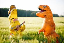 Two Yellow And Orange Dinosaur...