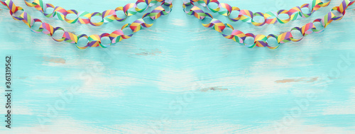 Fotografija Paper colorful chain garland over white wooden background