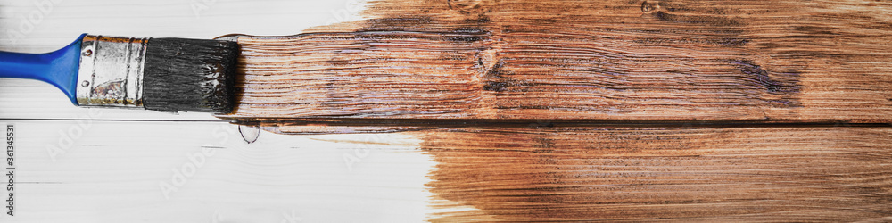 Fototapeta panorama of a wooden board with a brush and brown glaze