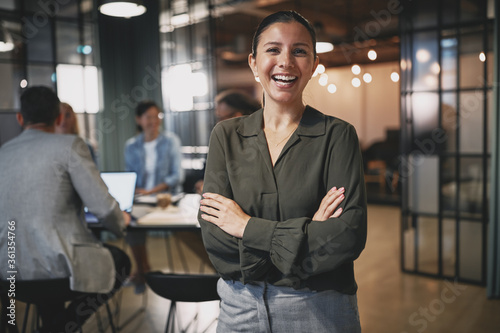 Young businesswoman laughing while working in a modern office
