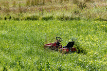 Lawn Tractor On Overgrown Grass