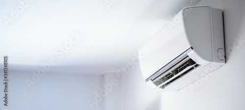 Fototapeta Air conditioner on white wall room interior background
