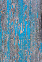 Close-up Of Weathered And Worn Wooden Panel With Blue Flaking Paint