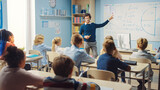 Caring Teacher Explains Lesson to a Classroom Full of Bright Diverse Children. In Elementary School with Group of Smart Multiethnic Learning Science, Listening to a Teacher with Great Interest