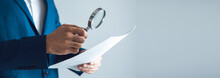 Man Hand Magnifier And Document
