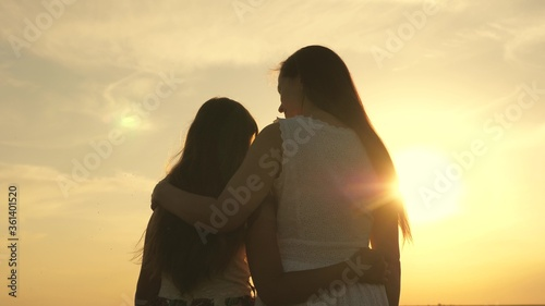 Fotografie, Tablou Happy family mom and daughter in field at sunset