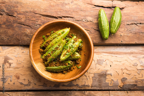 Indian style Bharwa Parwal or paraval dry Sabzi or Stuffed Pointed Gourd Dry fry, selective focus