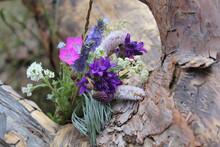 Beautiful Flowers On A Wood Te...