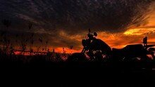 Motorcycle Silhouette At Sunset Time
