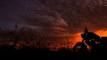 Motorcycle Silhouette At Sunse...