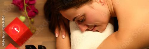 Valokuvatapetti Woman likes spa treatments in salon, near candles