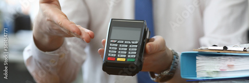 Canvastavla Man holds his hand wireless terminal for payment