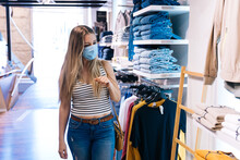 Young Woman In Mask Shopping A...