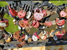 Multi-colored Wedding Locks On The Railing Of The Bridge Over The Vitba River, In The City Of Vitebsk, As A Symbol Of Eternal Love And Happiness. Traditions And Customs Of Peoples.
