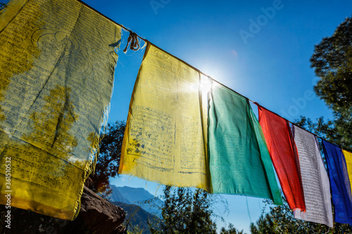Fotografija Prayer flags of Tibetan Buddhism with Buddhist mantra on it in Dharamshala monastery temple