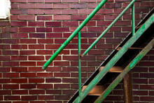 Rusty Green Iron Stairs With B...