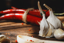 Garlic And Chili Pepper On Dar...