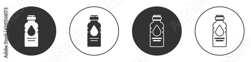 Black Bottle of water icon isolated on white background. Soda aqua drink sign. Circle button. Vector Illustration.