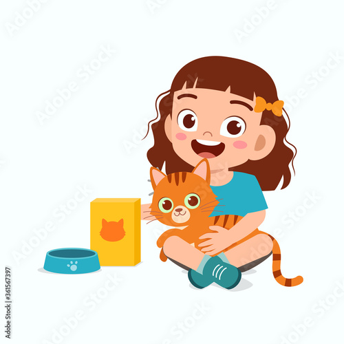 happy cute little kid girl play with pet cat