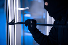 Robber In Black Balaclava Crac...